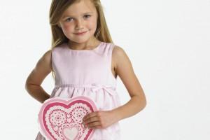 Little Girl in Pink Dress Holding  Heart